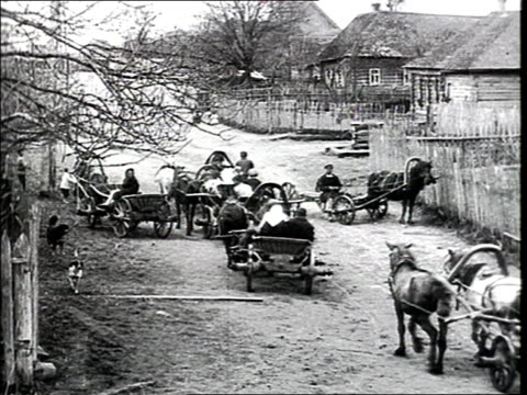 montage 'the bolshevik spring' village horse drawn carts wooden houses group of peasants women - 1925 stock videos & royalty-free footage
