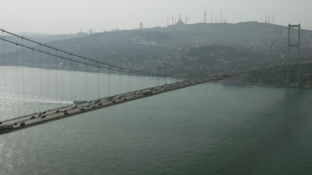 the bosphorus bridge spans the bosphorus strait - july 15 martyrs' bridge stock videos & royalty-free footage
