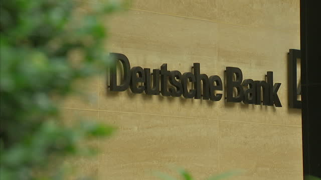 the boss of deutsche bank today moved to reassure his staff after a turbulent week of trading which saw its shares hit their lowest levels since the... - deutsche bank stock videos & royalty-free footage
