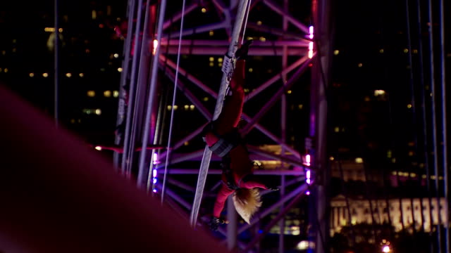 the boston based streb dance company attach themselves to the wires of the london eye performing a 20minute spectaclein this clip we see one of the... - solo performance stock videos and b-roll footage