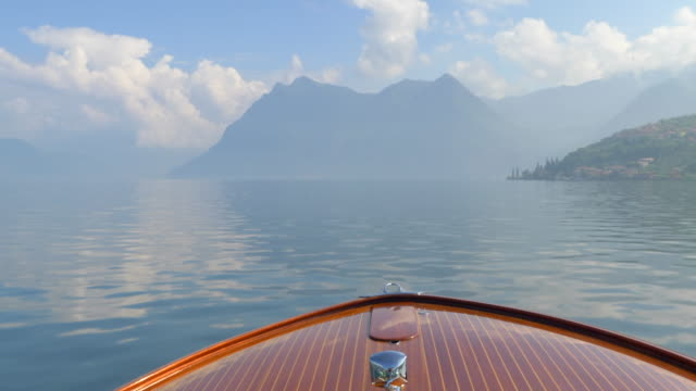 the bow of a classic luxury wooden runabout boat on an italian lake. - slow motion - motorboat stock videos & royalty-free footage