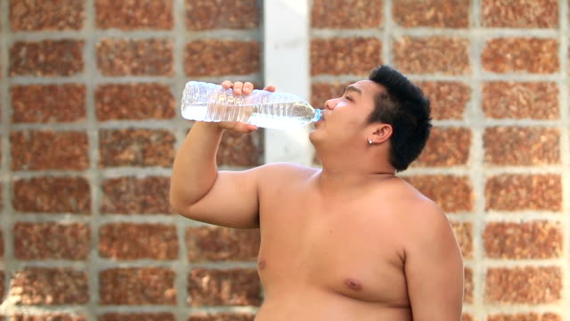 the boy is drinking water with thirst - thirsty stock videos & royalty-free footage