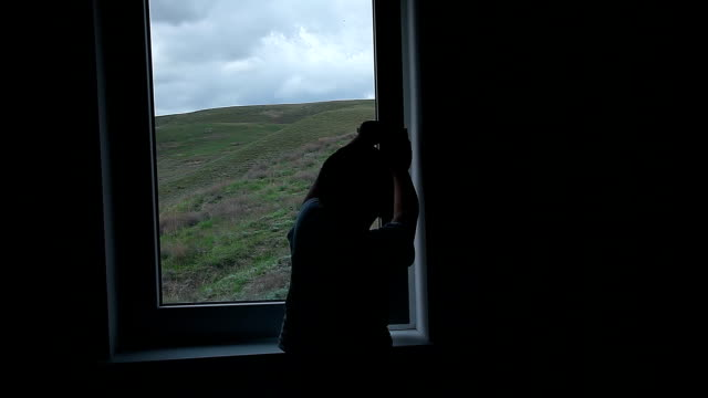 the boy opens the window and looks through it - baby boys stock videos & royalty-free footage