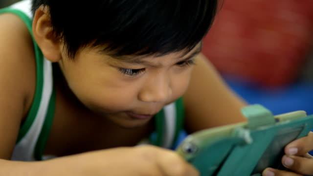 The boy play smartphone