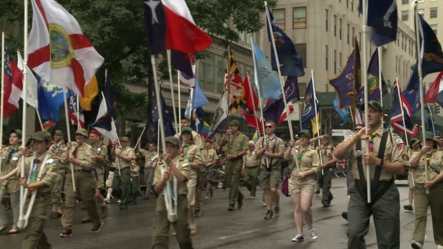the boy scouts of america show their support by marching in the parade down 5th avenue - boy scout stock videos & royalty-free footage
