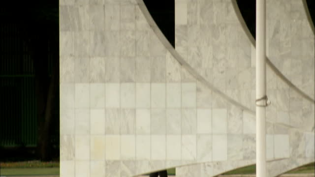 The Brazilian flag flutters by Brasilia's Supreme Federal Court Building. Available in HD.