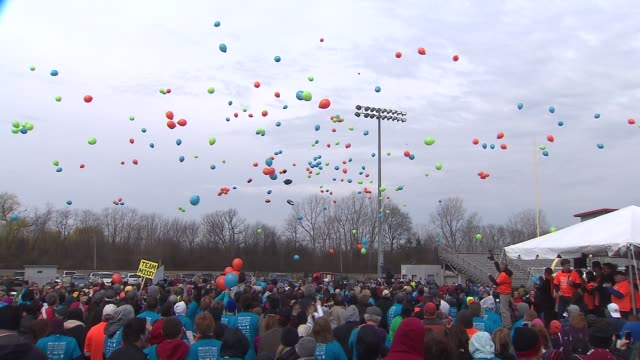 the breathe deep north shore event which raises crucial funds for lung cancer research held a balloon launch at the deerfield high school football... - illinois stock videos & royalty-free footage
