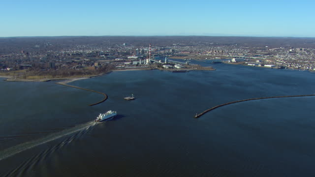 the bridgeport - port jefferson ferry enters the breakwaters of the bridgeport harbor at bridgeport, connecticut. - ferry stock videos & royalty-free footage