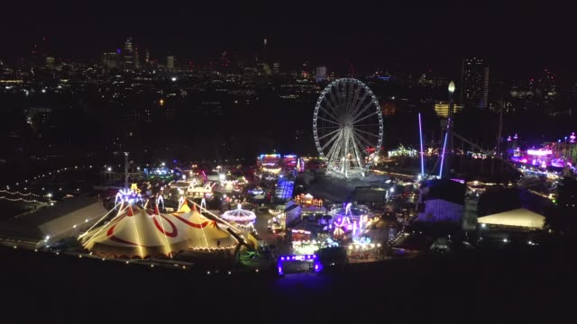 the bright lights of winter wonderland in londons hyde park as seen by drone - luminosity stock videos & royalty-free footage