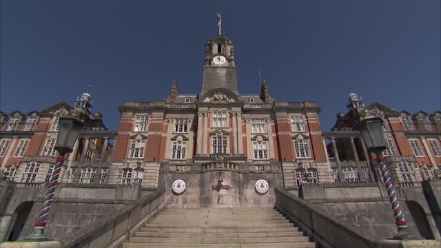 The Britannia Royal Naval College looms against a blue sky.