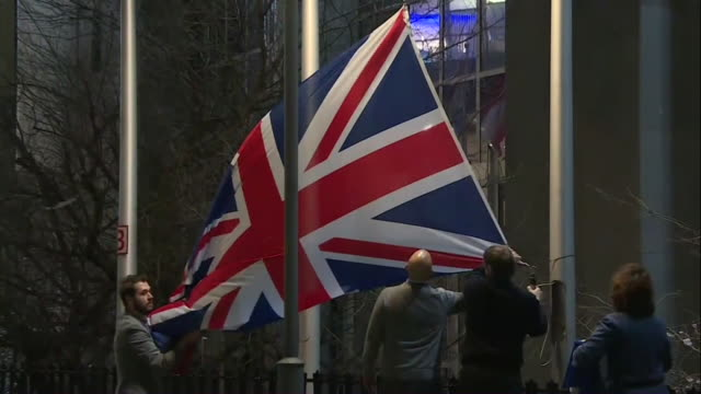 the british flag being removed from the eu parliament building - pole stock videos & royalty-free footage