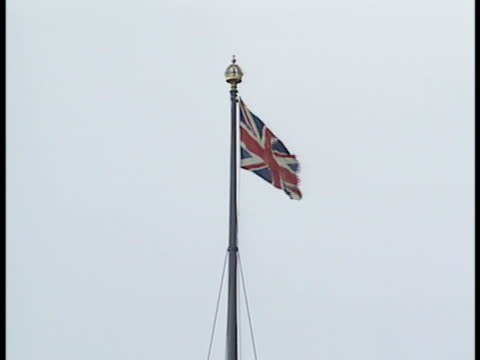 The British flag flies above the Victoria Tower at London England's Houses of Parliament