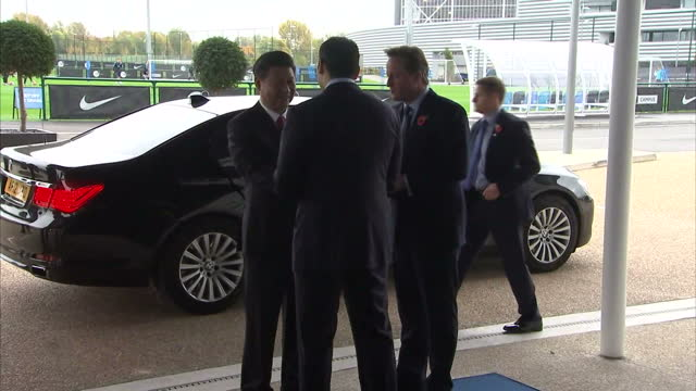 The British Prime Minister David Cameron and the Chinese President Xi Jinping arriving at Manchester City Football Club on October 23 2015 in...