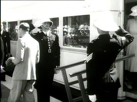 the british royal family disembarks from a train and gets into a rollsroyce on a tour of south africa 1947 - rolls royce stock videos & royalty-free footage