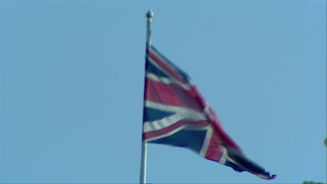 The British Union Jack waves in a stiff breeze. Available in HD.