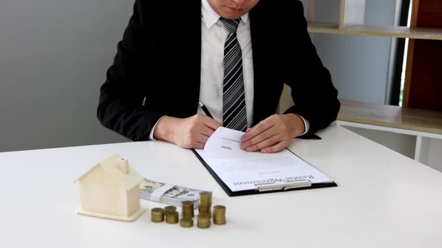 the broker sells the house to the investors sitting in the office. - law stock videos & royalty-free footage