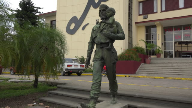 the bronze statue of che guevara with child the artwork is located in the provincial headquarters of the communist party in santa clara city cuba the... - communist party stock videos and b-roll footage