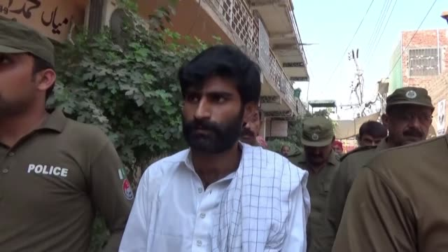 the brother of pakistani social media star qandeel baloch arrives at a court in multan before being sentenced to life in prison for her murder the... - multan stock videos and b-roll footage