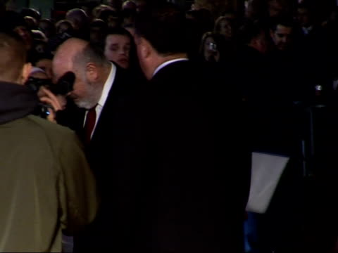 'the bucket list' premiere arrivals and interviews rob reiner signing autographs on red carpet - autogramm stock-videos und b-roll-filmmaterial