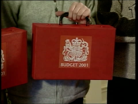 john england london downing street no11 chancellor of the exchequer gordon brown mp hands red lookalike budget box to school child cms lookalike... - chancellor of the exchequer stock videos and b-roll footage