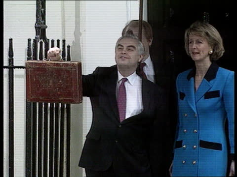the budget naf london downing st no 11 ms norman lamont mp holding up budget box as wife rosemary next ms ditto - budget stock-videos und b-roll-filmmaterial