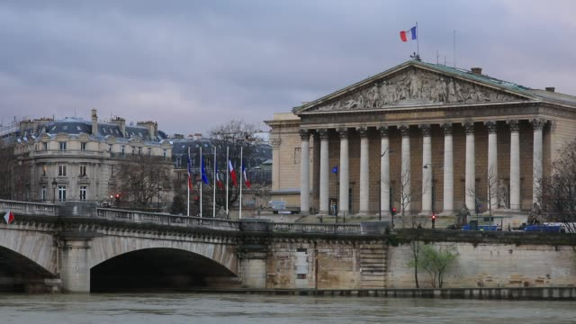 the building of french national parliament with a french flag on march 10 2020 in paris france - french culture stock videos & royalty-free footage