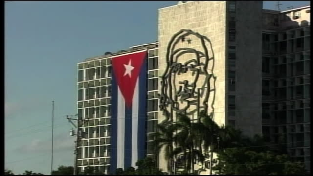 The building of Ministry of the Interior with a 8 storey tall basrelief of Ernesto Che Guevara and a Cuban national flag hanging on the façade of it