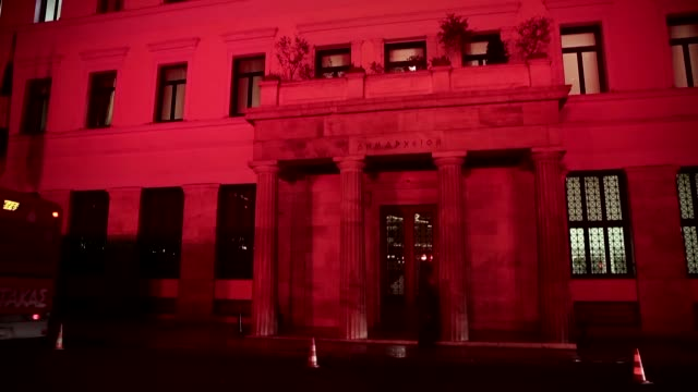 The building of the Athens municipality is illuminated in the colors of the Turkish flag on December 12 2016 in solidarity with Turkey after the...