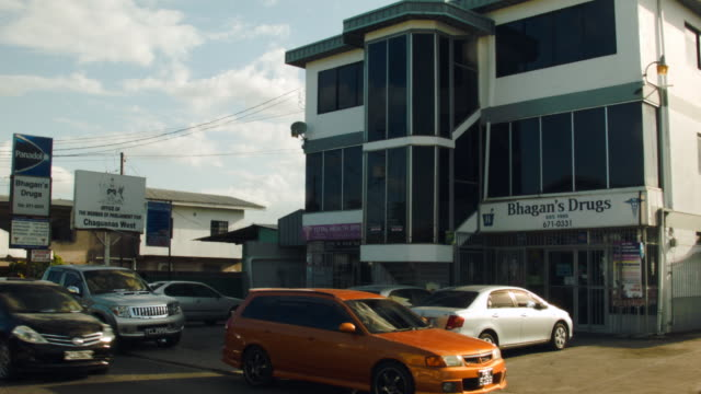 the building where the parliament office of former fifa vice-president jack warner is located on the second floor is seen on june 9, 2015 in... - trinidad trinidad and tobago stock videos & royalty-free footage