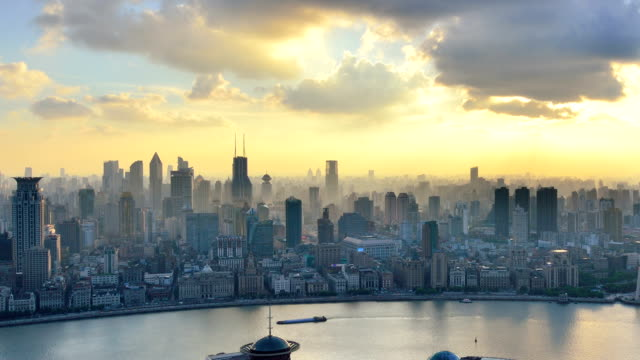the bund and huangpu river of shanghai, china - day to sunset stock videos & royalty-free footage