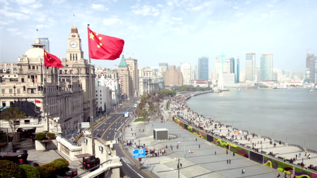 the bund in shanghai - chinese flag stock videos and b-roll footage