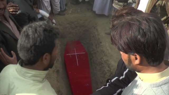 The burial of victims of a suicide bomb attack on a Pakistan church claimed by the Islamic State group took place Monday in Quetta