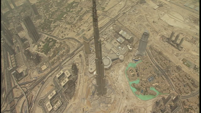 The Burj Dubai Tower spikes into the sky in an aerial view.