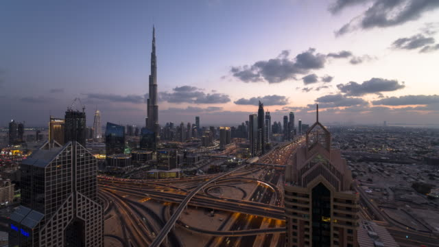 the burj khalifa dubai, elevated time lapse looking across sheikh zayed road and the financial centre road interchange, downtown dubai, dubai, uae - dubai stock videos & royalty-free footage