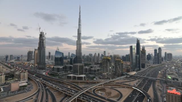 the burj khalifa dubai, elevated time lapse looking across sheikh zayed road and the financial centre road interchange, downtown dubai, dubai, uae - burj khalifa stock videos & royalty-free footage