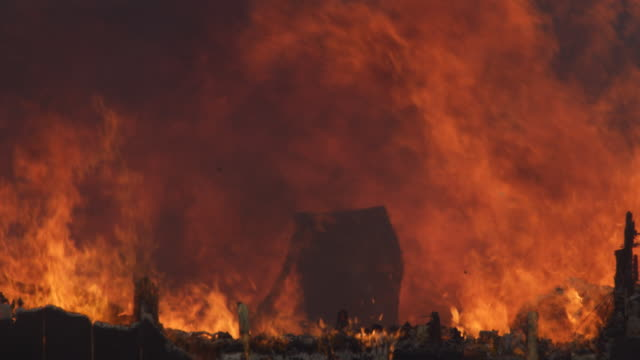 the burning, charred remains of a structure still on fire - myrtle creek stock videos and b-roll footage