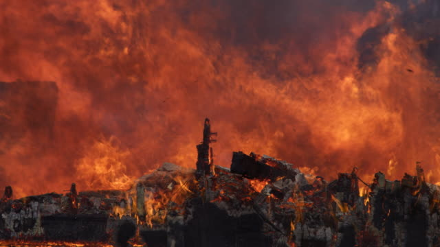 the burning, charred remains of a structure with the fire still raging - myrtle creek stock videos and b-roll footage