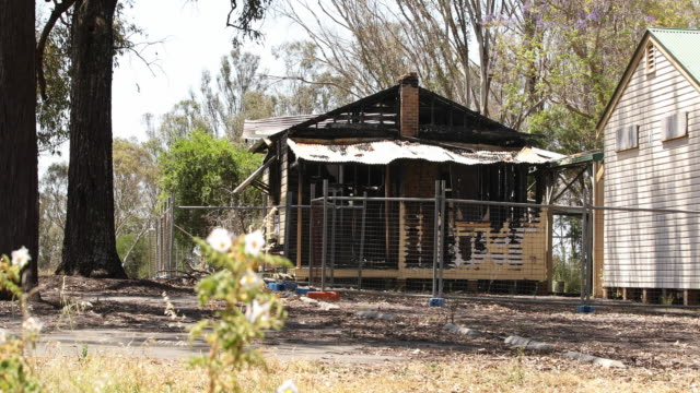 the burnt out remains of a building of the abandoned badgerys creek public school is seen on november 07 2016 in sydney australia the school was... - imperium bildbanksvideor och videomaterial från bakom kulisserna