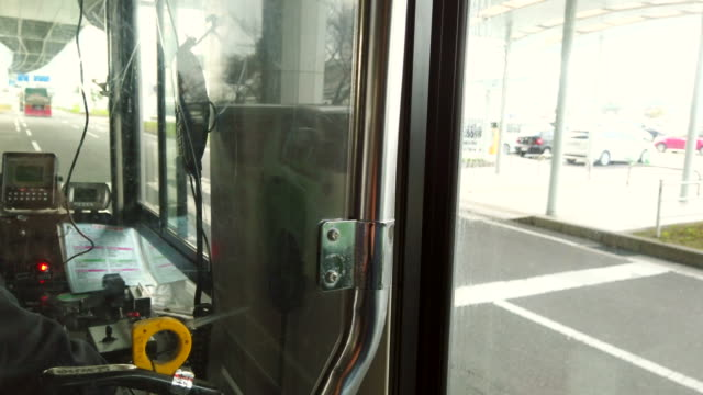 the bus driver is driving along the road. - bus driver stock videos & royalty-free footage