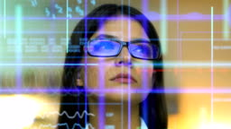 The business woman in glasses looking to the screen on the hologram background