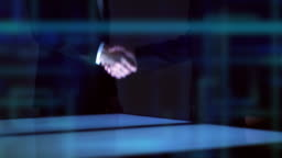 The businessmen handshake above a screen on a hologram background. slow motion