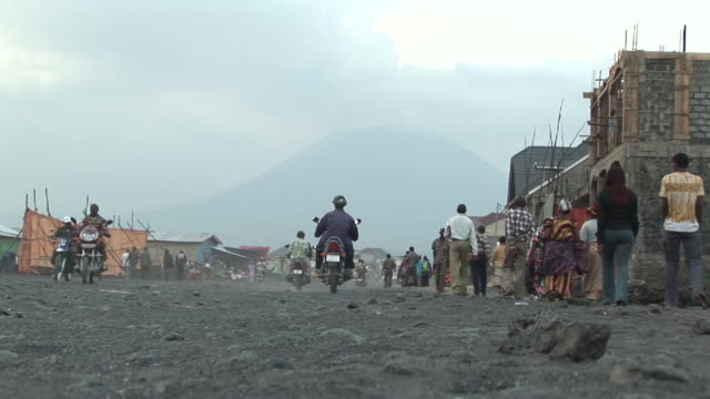 The bustle at the street,  the vulcano at background
