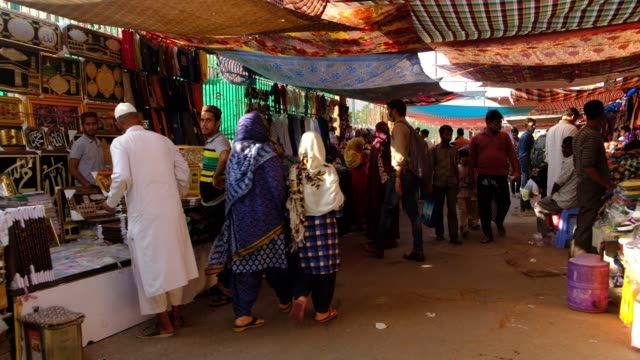 the busy market in front of masjidi jehan numa commonly known as the jama masjid of delhi one of the largest mosques in india made of red sandstone... - sandstone stock videos & royalty-free footage