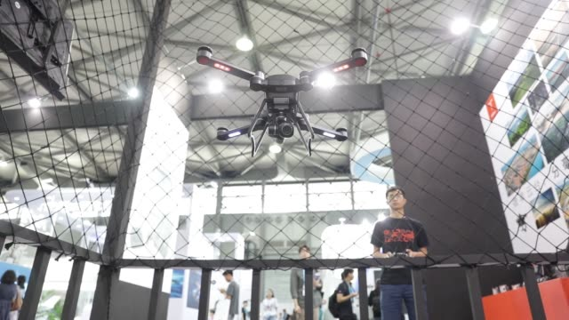 the byrd premium 20 drone manufactured by gdu technology co ltd hovers during a demonstration at the company's booth at the consumer electronics show... - trade show booth stock videos & royalty-free footage