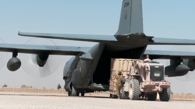 the c-130 hercules plays an instrumental part in troop and cargo movement in afghanistan as retrograde operations continue here at forward operating... - international security assistance force stock videos & royalty-free footage
