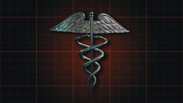 the caduceus medical symbol rotating on an orange grid (loop). - caduceus stock videos and b-roll footage