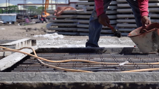 HD SLOW MOTION: The cage of reinforcement bar on the construction site