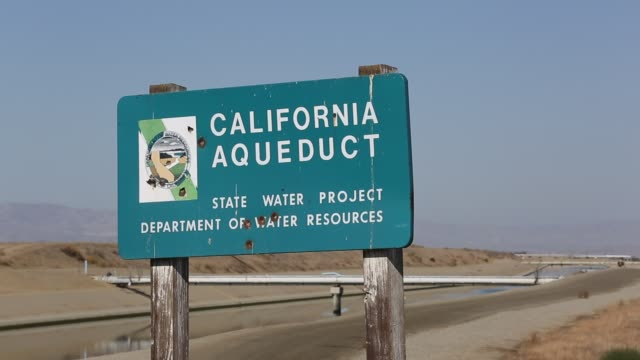 the california aqueduct that brings water from snowmelt in the sierra nevada mountains to farmland in the central valley. following a four year long... - irrigation equipment stock videos & royalty-free footage