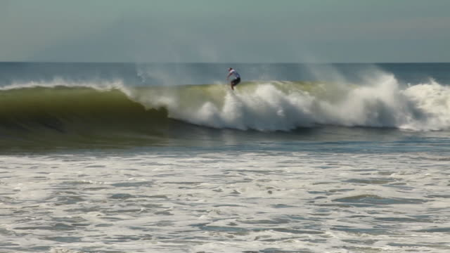 the camera follows kelly on his perfect wave and then pans to the crowd. - contest stock videos & royalty-free footage