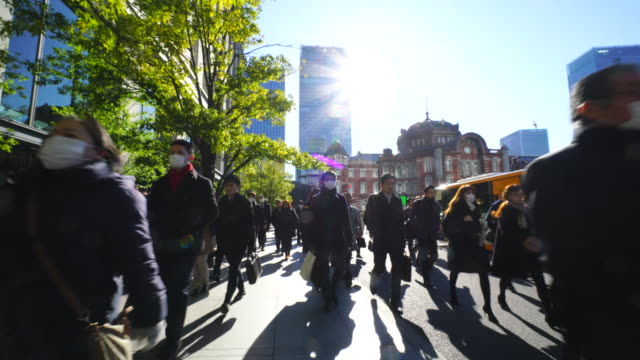tl the camera goes through against the morning commute crowd.commuters go to marunouchi business district from tokyo station. - marunouchi stock videos & royalty-free footage